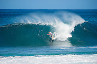 PIPELINE, Oahu, Hawaii (Sunday, December 8, 2013) Dusty Payne (HAW). - The opening day of the Billabong Pipe Masters, in Memory of Andy Irons, commenced today in firing six-to-eight foot (2 metre) waves and the world's best surfers put on an incredible display of technical barrel riding at Pipeline and Backdoor to complete Rounds 1 and 2. The Billabong Pipe Masters is the third and final leg of the Vans Triple Crown of Surfing.<br /> <br /> The final stop on the ASP World Championship Tour (WCT), the Billabong Pipe Masters will decide the 2013 ASP World Title Race, the coveted Vans Triple Crown of Surfing Champion and the final qualification slots for next season's Top 34. <br /> Gabriel Medina (BRA), 19, would put together an amazing show at the iconic lefts of Pipeline to kick off the Billabong Pipe Masters, navigating through a heavy barrel on his opening score to post a near-perfect 9.67. The Brazilian Prodigy would quickly back up the ride, earning an additional 9 point score for another deep Pipe tube punctuated with a massive alley-oop, eliminating Bruce Irons (HAW), 34. Medina's unlikely aerial at Pipeline puts him in the running for a 250,000 mile prize from   Hawaiian Airlines Airshow award.<br /> Sebastian Zietz (HAW), 25, defending Vans Triple Crown of Surfing Champion, immediately found his rhythm at Pipeline, earning the first perfect 10-point ride of Billabong Pipe Masters competition for an unbelievable Backdoor barrel.<br /> Photo: joliphotos.com