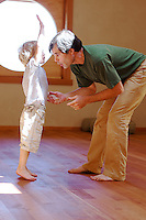 Tias Little and son, Eno, play around with partner dance improv in their yoga studio