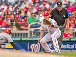 21 May 2014: Washington Nationals first baseman Tyler Moore attempts a pick-off of Cincinnati Reds second baseman Brandon Phillips during a game at Nationals Park in Washington, DC. The Reds edged out the Nationals 2-1 to take the rubber match of their 3-game series. Mandatory Credit: Ed Wolfstein Photo *** RAW (NEF) Image File Available ***
