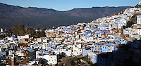 The town of Chefchaouen in the Rif mountains of North West Morocco. Chefchaouen was founded in 1471 by Moulay Ali Ben Moussa Ben Rashid El Alami to house the muslims expelled from Andalusia. It is famous for its blue painted houses, originated by the Jewish community, and is listed by UNESCO under the Intangible Cultural Heritage of Humanity. Picture by Manuel Cohen