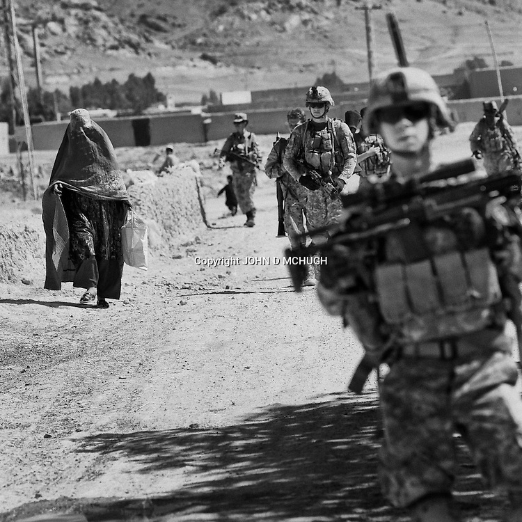 2nd Platoon, Lightening troop, 4th Squadron, 2nd Srtyker Cavalry Regiment (2/L/4/2SCR) search for Taliban weapons in pomegranete orchards on the west of Kandahar City, 22 April 2011. (John D McHugh)