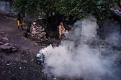 Residents coke coal next their house in Ghanudih in Jharia, outside of Dhanbad in Jharkhand, India.  Photo: Sanjit Das/Panos for FT Magazine