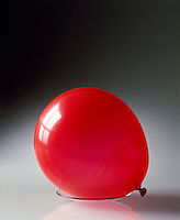 CHARLES' LAW: INFLATED BALLOON AT ROOM TEMPERATURE (1 of 2)<br /> Gas Volume Is Proportional To Temperature<br /> As liquid nitrogen (-196'C or 77'K) is poured over a balloon containing gas at a constant pressure, the gas trapped in the balloon is cooled and the volume decreases in direct proportion to the decrease in temperature .