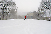 A lone pedestrian walks across a Bascom Hill walkway during a sudden winter snowstorm.<br /> <br /> Client: University of Wisconsin-Madison<br /> &copy; UW-Madison University Communications 608-262-0067<br /> Photo by: Michael Forster Rothbart<br /> Date:  2/03    File#:   D100 digital camera frame 1136.