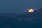 Full moon setting over the Sierra Nevada, Toiyabe National Forest, California