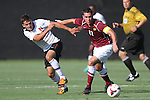 30 August 2013: Elon's Daniel Lovitz (11) and Northeastern's Donovan Fayd'Herbe de Maudave (left). The Elon University Phoenix played the Northeastern University Huskies at Koskinen Stadium in Durham, NC in a 2013 NCAA Division I Men's Soccer match. The game ended in a 1-1 tie after two overtimes.