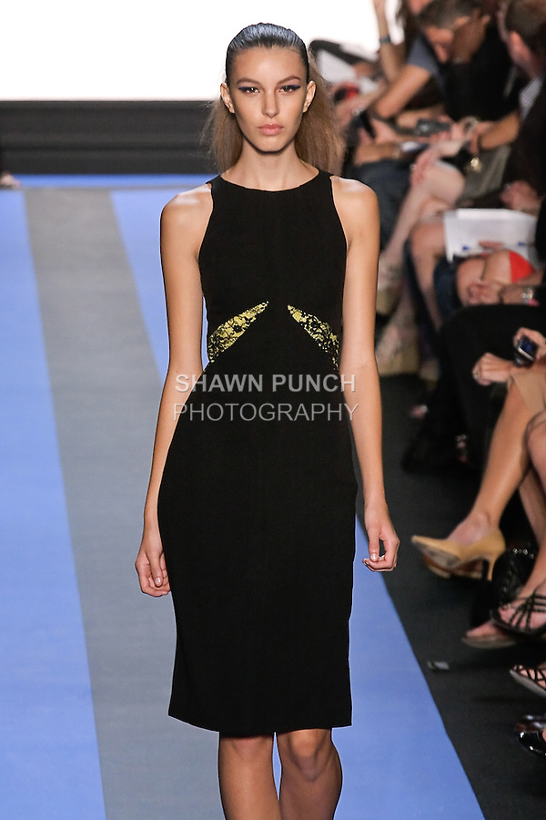 Kate walks runway in a carbon black crepe cocktail with side slash insets, by Monique Lhuillier, from the Monique Lhuillier Spring 2012 collection fashion show, during Mercedes-Benz Fashion Week Spring 2012.