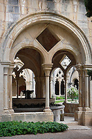 Low angle view through the cloister featuring a fountain, Monestir de Poblet, 1151, Vimbodi, Catalonia, Spain, pictured on May 20, 2006, in the afternoon. The Monastery of Poblet belongs to the Cistercian Order and was founded by French monks. Originally, Cistercian architecture, like the rules of the order, was frugal. But continuous additions  including late Gothic and Baroque, eventually made Poblet one of the largest monasteries in Spain which was later used as a fortress and royal palace. It was closed in 1835 by the Spanish State but refounded in 1940 by Italian Cistercians. It is a UNESCO World Heritage Site. Picture by Manuel Cohen.