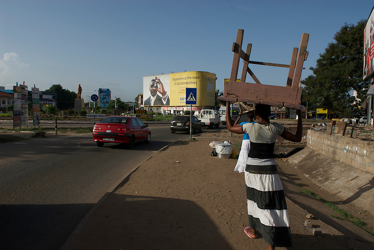 Mobile network  advertising dominates many Accra city scenes.