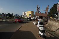 Mobile network  advertising dominates many Accra city scenes.