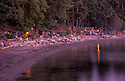 Beach and waterfront cabins at West Beach Resort at sunset on Orcas Island; San Juan Islands, Washington.
