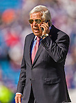 12 October 2014: New England Patriots Chairman and CEO Robert Kraft takes a call on the sidelines prior to a game against the Buffalo Bills at Ralph Wilson Stadium in Orchard Park, NY. The Patriots defeated the Bills 37-22 to move into first place in the AFC Eastern Division. Mandatory Credit: Ed Wolfstein Photo *** RAW (NEF) Image File Available ***