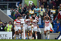 Japan players celebrate Karne Hesketh's match-winning try in the final play. Rugby World Cup Pool B match between South Africa and Japan on September 19, 2015 at the Brighton Community Stadium in Brighton, England. Photo by: Patrick Khachfe / Onside Images
