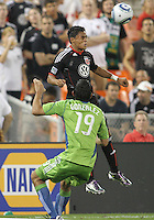 Andy Najar #14 of D.C. United beats Leonardo Gonzalez #19 of Seattle Sounders FC to a header during an MLS match at RFK Stadium on July 15 2010, in Washington DC.Seattle won 1-0.
