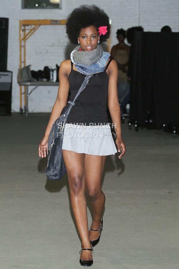 Model walks runway in a denim outfit by René Stewart-Pearce, during Fashion Week Brooklyn Fall Winter 2015.