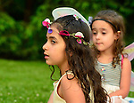 Old Westbury, New York, U.S. 22nd June 2013. Many young girls are wearing fairy costumes at the Midsummer Night event at Old Westbury Gardens, with dances performed throughout the illuminated grounds of the historic Long Island Gold Coast estate.