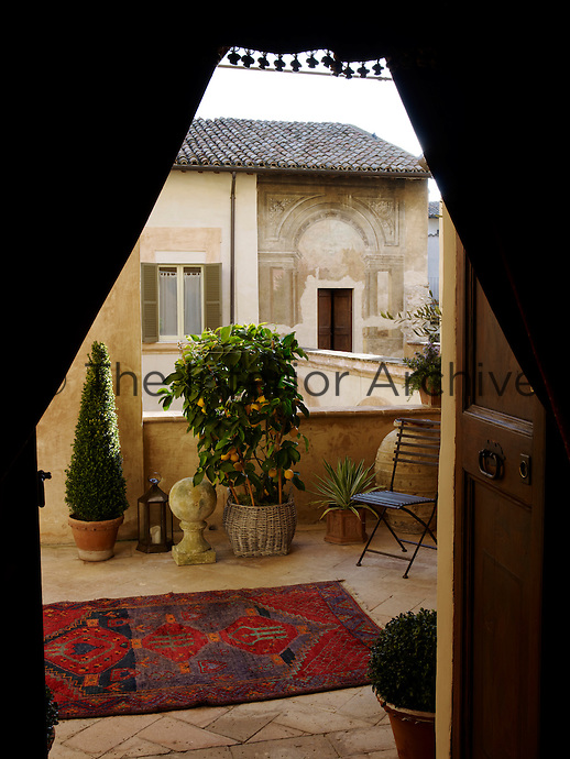 A secluded roof terrace looks out over another wing of the restored palazzo and the frescos above the door