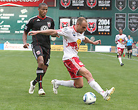Jordan Graye #16 of D.C. United moves in on Joel Lindpere #20 of the New York Red Bulls during an MLS match on May 1 2010, at RFK Stadium in Washington D.C.