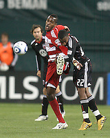 Rodney Wallace #22 of D.C. United tangles with Anthony Wallace #26 of F.C. Dallas during a US Open Cup match on April 28 2010, at RFK Stadium in Washington D.C. United won 4-2.