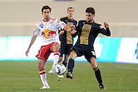 Austin Da Luz (13) of the New York Red Bulls and Cristian Arrieta (26) of the Philadelphia Union go for the ball. The New York Red Bulls defeated the Philadelphia Union 2-1 during a US Open Cup qualifier at Red Bull Arena in Harrison, NJ, on April 27, 2010.