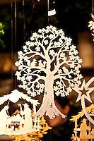 Wooden carved hanging ornaments  at Christmas market, Winter Wonderland, in Hyde Park, London