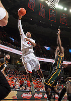 CHARLOTTESVILLE, VA- DECEMBER 6: Akil Mitchell #25 of the Virginia Cavaliers shoots over a George Mason Patriot defender during the game on December 6, 2011 at the John Paul Jones Arena in Charlottesville, Virginia. Virginia defeated George Mason 68-48. (Photo by Andrew Shurtleff/Getty Images) *** Local Caption *** Akil Mitchell
