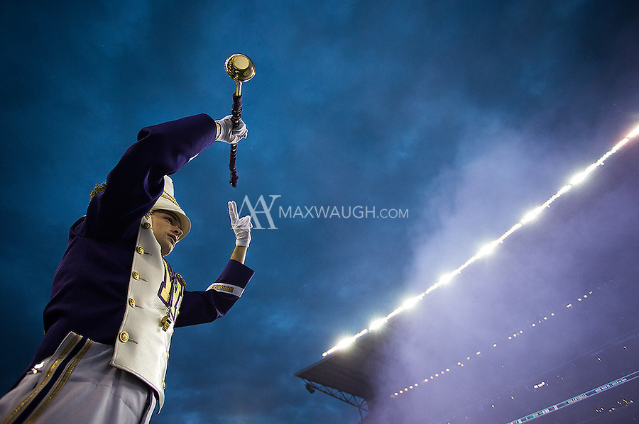Husky drum major Zach Baisch conducts the band as the team enters Husky Stadium.