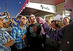 A heated debate erupts between Leandro Seoane, wearing an Obama t-shirt and anti-Castro demonstrators  outside Versaille's Restaurant after President Obama's decision to normalize relations between Cuba and the United States on Wednesday, December 17, 2014