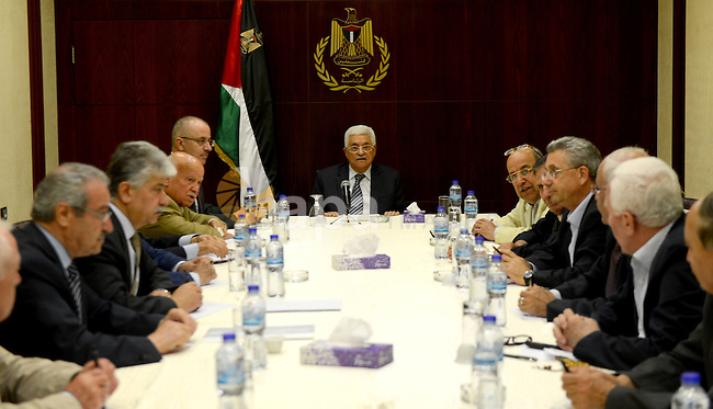 Palestinian President, Mahmoud Abbas (Abu Mazen) chairs a meeting of the Executive Committee in the West Bank city of Ramallah on June 30, 2015. Photo by Osama Falah