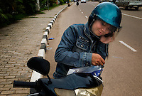 Vientiane, Laos, August 12, 2007.Mobilephone romance...