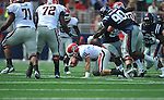 Georgia quarterback Aaron Murray (11) falls to the ground as Ole Miss' Gerald Rivers (90) rushes at Vaught-Hemingway Stadium in Oxford, Miss. on Saturday, September 24, 2011. Georgia won 27-13.