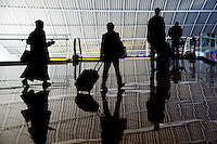 Passengers race to their airplanes at Baltimore Washington International Airport (BWI)