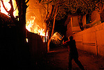 A random act of arson sees another building go up in  flames at Kampung Alor,Dili East Timor 04/06/06