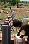 Boy filling a tank with guinea worm-free water. A cloth filter was placed at the end of the tap. Water will be sold in town. Savelugu, Northern Region, Ghana.