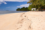 Canopied day beds and shaded hammocks line the wide beach at Siladen Resort and Spa, on Siladen Island, off North Sulawesi, Indonesia.
