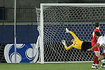 12 December 2008: Graham Zusi (right) of Maryland begins his celebration as his game winning goal hits the net past the outreached dive of goalie Neal Kitson of St. John's.  The University of Maryland Terrapins defeated the St. John's University Red Storm 1-0 during the second sudden death overtime at Pizza Hut Park in Frisco, TX in an NCAA Division I Men's College Cup semifinal game.