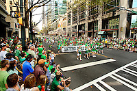 Photography of the Charlotte NC St. Patrick's Day Parade in March 2012. Image shows the parade proceeding along Tryon Street. Photography is part of a series of St. Patrick's Day Parade photos in Charlotte, NC.