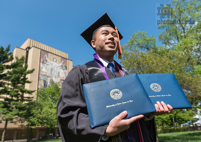 May 15, 2016; Double major holds his two diplomas, Commencement 2016. (Photo by Matt Cashore/University of Notre Dame)