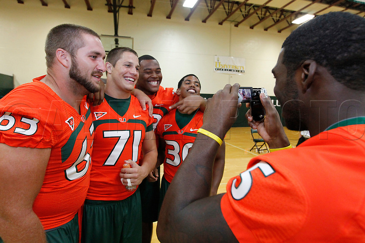 Mike Jakes, at right, shoots video and interviews his teammates, Tyler Horn, Anthony Chickillo, Marcus Forston and AJ Highsmith during Media Day for the University of Miami Football team on Campus in Coral Gables on August 27, 2011.