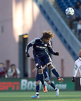 New England Revolution defender Kevin Alston (30) heads the ball. In a Major League Soccer (MLS) match, the New England Revolution defeated DC United, 2-1, at Gillette Stadium on March 26, 2011.