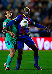 Levante's Kone (R) vies for the ball with FC Barcelona's Javier Mascherano (R) during the Spanish league football match Levante UD vs FC Barcelona on April 14, 2012 at the Ciudad de Valencia Stadium in Valencia. (Photo by Xaume Olleros/Action Plus)