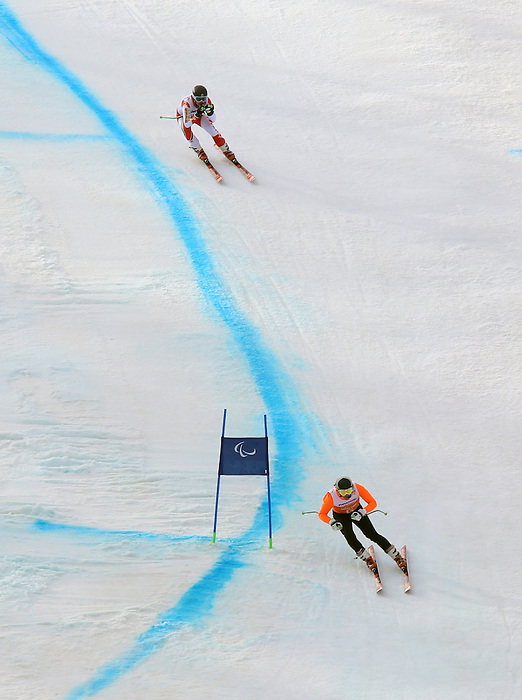 Sochi, Russia,08/03/2014. Canadian skier Mac Marcoux and guide Robin Femyski to a bronze medal in the mens Downhill, Visually impared during the 2014 Paralympic Winter Games Games.(Photo:Scott Grant/Canadian Paralympic Committee