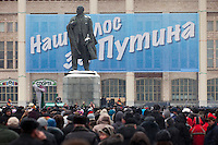 "Moscow, Russia, 23/02/2012..A statue of Lenin with a banner behind reading ""Our voice is for Putin"" as some 130,000 people attend a rally at Luzhniki sports stadium supporting Prime Minister Vladimir Putin's presidential election campaign."