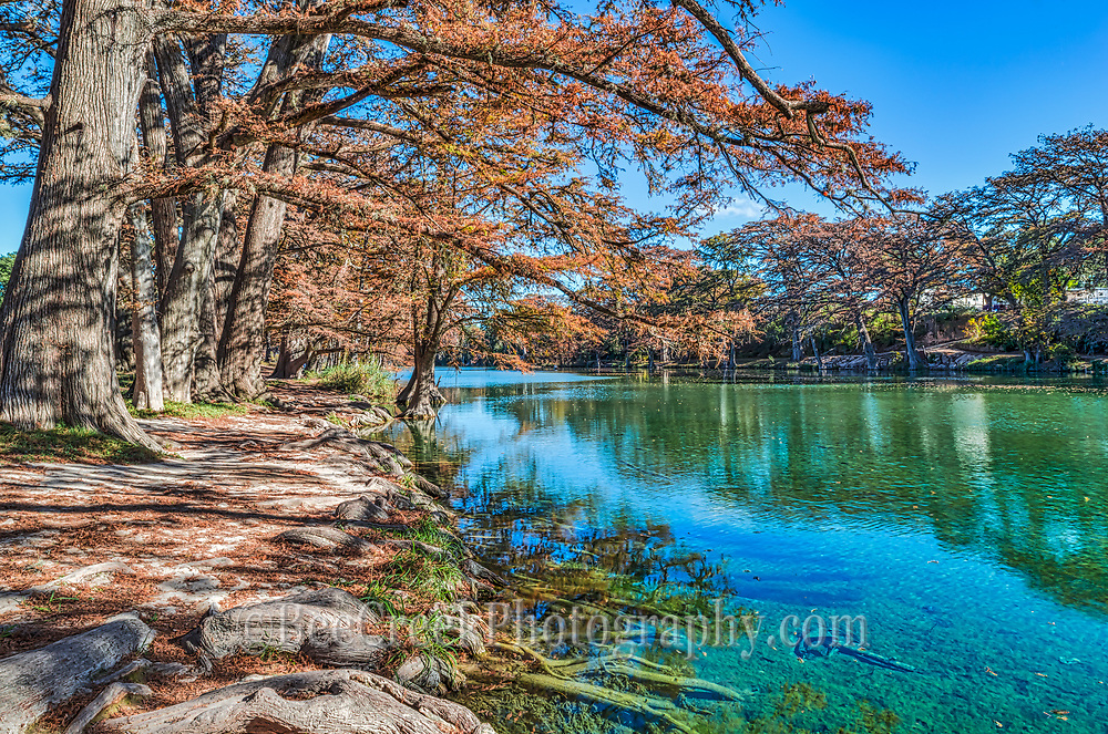 Garner State Park is beautiful and you can see the cool clear blue green waters of the Frio River on this fall day. Fall in the Texas hill country has some beautiful scenic landscapes.