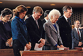 United States President George H.W. Bush, and first lady Barbara Bush, second right, attend a church service at Fort Myer with US Vice President Dan Quayle, center, and Mrs. Marilyn Quayle, center right,  on January 17, 1991.  Pictured at right is President and Mrs. Bush's daughter Dorothy.<br /> Mandatory Credit: David Valdez / White House via CNP