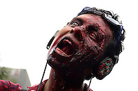 D.F. Mexico, November 23. 2013. A man attends a rally while  Thousands of people dressed as zombies take part in a march from the plaza of the three cultures on the Paseo de la Reforma Avenue to the Angel of Independence.  VIEWpress/Miguel Angel Pantaleon