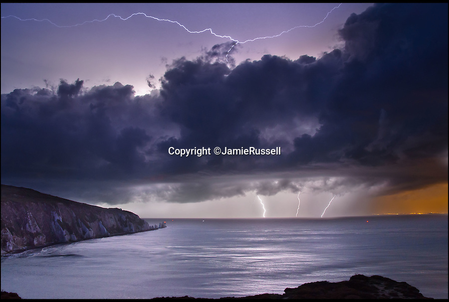 BNPS.co.uk (01202 55883&pound;)<br /> Pic: JamieRussell/BNPS<br /> <br /> ***Please Use Full Byline***<br /> <br /> Storm over the Needles. <br /> <br /> Stunning photographs have revealed a turbulent side to the normally genteel Isle of Wight.<br /> <br /> The seemingly benign south coast holiday destination has been catalogued over a stormy year by local photographer Jamie Russell, and his astonishing pictures reveal the dramatic changes in weather that roll across the UK in just 12 months.<br /> <br /> Lightning storms, ice, floods, gales and blizzards have all been captured by the intrepid photographer who frequently got up in the middle of the night to capture the climatic chaos.<br /> <br /> Looking at these pictures prospective holidaymakers could be forgiven for thinking twice about a gentle staycation on the south coast island.