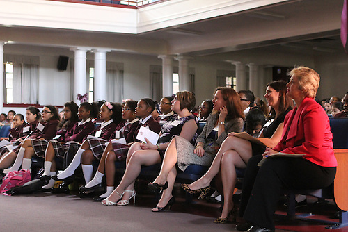Houston Mayor Annise Parker, far right, listens to a presentation at the Young Women's College Preparatory Academy.