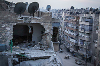 In this Thursday, Nov. 29, 2012 photo, a destroyed building is seen at one street in Sa'ar where warplanes have bombed several times the neighborhood durind months of fighting in Aleppo, the Syrian's largest city. (AP Photo/Narciso Contreras).