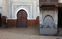 View from the front of the entrance to the Foundouk el-Nejjarrine with the Seffarine Fountain on the right, Fez, Morocco, pictured on February 24, 2009 in the morning. The Fondouk el-Nejjarine, previously a hostel providing food and shelter for traders, is now the Museum of Wooden Arts and Crafts. It has been beautifully restored and exhibits including domestic, architectural and liturgical woodwork, are displayed over three floors. Nejjarine means carpenter, and the Fondouk is near the Nejjarine Souk where carpenters still may be seen at work. Fez, Morocco's second largest city, and one of the four imperial cities, was founded in 789 by Idris I on the banks of the River Fez. The oldest university in the world is here and the city is still the Moroccan cultural and spiritual centre. Fez has three sectors: the oldest part, the walled city of Fes-el-Bali, houses Morocco's largest medina and is a UNESCO World Heritage Site;  Fes-el-Jedid was founded in 1244 as a new capital by the Merenid dynasty, and contains the Mellah, or Jewish quarter; Ville Nouvelle was built by the French who took over most of Morocco in 1912 and transferred the capital to Rabat. Picture by Manuel Cohen.